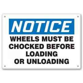 NOTICE - Wheels Must Be Chocked Before Loading Or Unloading
